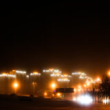 City lights and winter mist