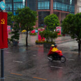 Downpour over Communist Flags